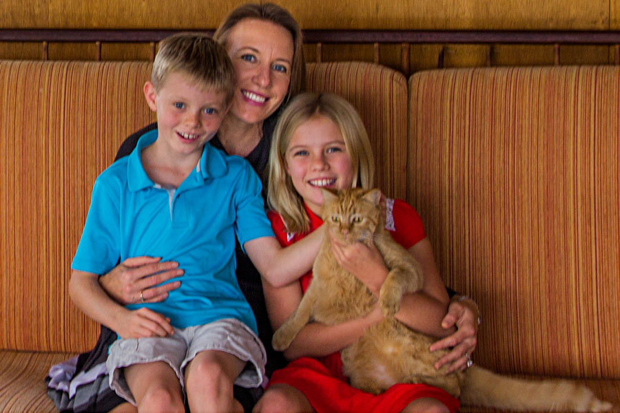 Catherine, Oliver, and Ava Blakespear with their family cat, Bella.
