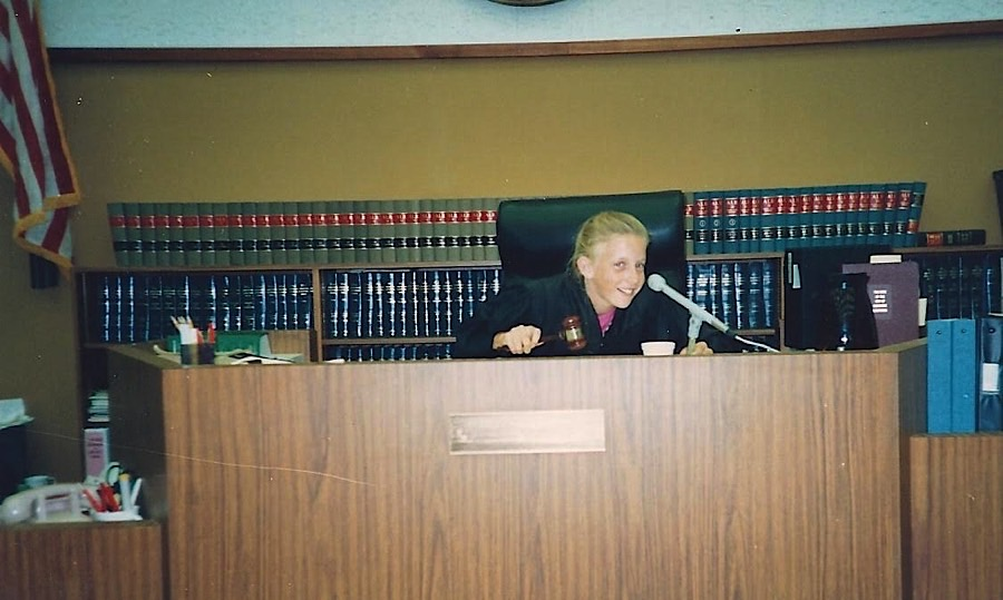 At age 11, Catherine took a chance to hit the gavel at the dais after her mom, Tricia A. Smith, finished sitting as a temporary judge for the day. A little bit of foreshadowing.